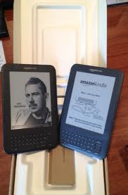 An image of two kindle's right out of the box.