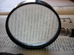 A magnify glass stressing the importance of keyword research.